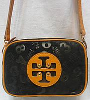 Стильная маленькая сумочка замшевой кожи.