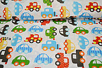 Ткань с разноцветными автомобилями (зелёными и голубыми) №231а