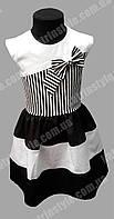 Летнее платье для девочек в чёрно-белую полоску украшенное бантиком