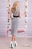 Костюм, который состоит из раздельных юбки и верхнего топа.
