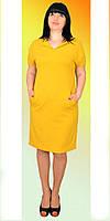 Красивое платье с декоративными пуговичками сзади