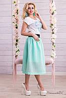Женская юбка ниже колен с завышенной талией