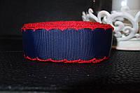 Лента репсовая синяя с красной  обвязкой.