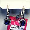 Серебряные серьги-подвески с синим цирконом 21094с