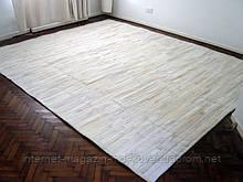 Білий килим з шкури корови нестандартного розміру
