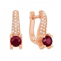 Золотые серьги с рубинами и бриллиантами.