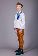 Мальчиковая сорочка с воротничком и синим орнаментом