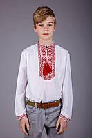 Вышитая рубашка на мальчика с красным орнаментом на белом батисте
