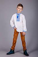 Вышитая рубашка крестиком на белом лене с синим узором