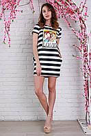Интересное молодежное платье из дайвинга с карманами в боковых швах и яркими принтами.