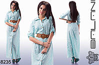Женское летнее платье в пол с поясом, спереди застегивается на пуговицы.
