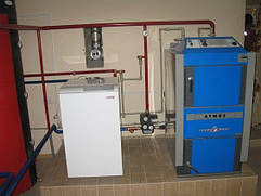 Подключение твердотопливного котла длительного горения ATMOS специалистами фирмы Тепло без газа