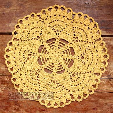 Вязаная салфетка круглая желтая
