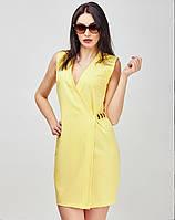 Коктельное платье желтого цвета с глубоким вырезом