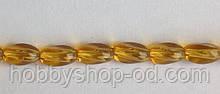 Намистина Овал кручений колір янтарний 6*9 мм