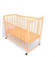 Деревянная кроватка-качалка с колесами
