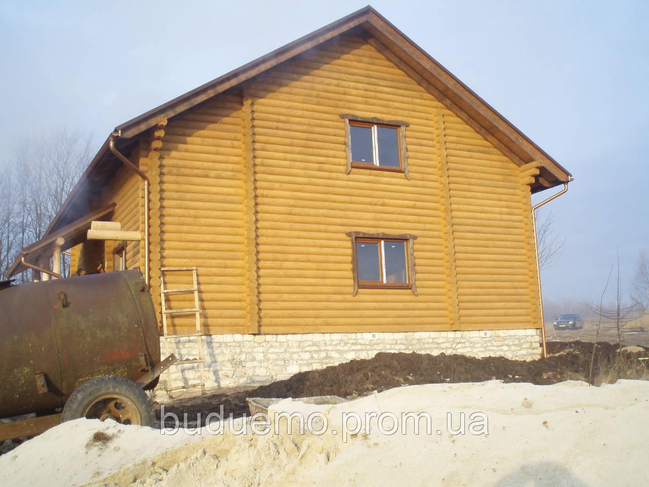 Будівництво будинків з оціліндрованого брусу.