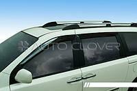 Дефлектори вікон вітровики Kia Carnival 2006-