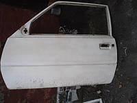Дверь передняя левая голая Таврия ЗАЗ 1102 в среднем состоянии