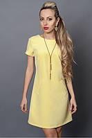 Оригинальное платье лимонного цвета