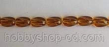 Намистина Овал кручений колір янтарний 8*11 мм