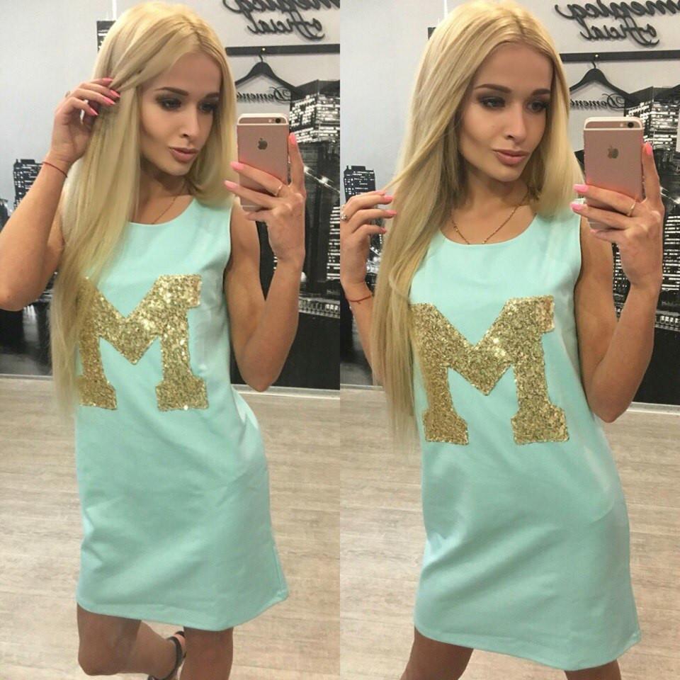 Трикотажное платье с пайетками