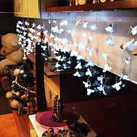 Гирлянда штора из 120 цветочков в интерьере квартиры нашего постоянного клиента