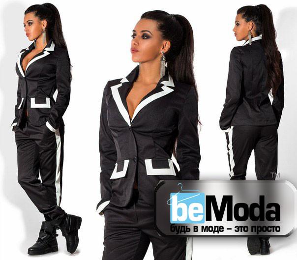 Деловой женский костюм с контрастными вставками черный