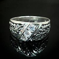 Серебряное кольцо с орнаментом и вставками из прозрачного фианита