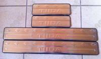 Накладки на пороги хромированные Nissan Tiida