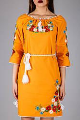 Жіноче плаття на яскравої тканини з вишивкою гладдю