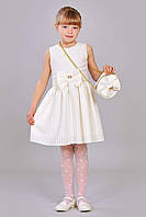 Молочное платье для девочки с пышной юбкой