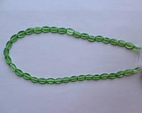 Бусина Овал плоский цвет зеленый  6*9 мм