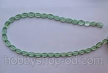 Намистина Овал плоский колір св. зелений 6*9 мм