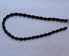 Намистина Овал плоский колір чорний 6*9 мм