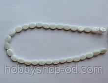 Намистина Овал плоский колір білий 8*11 мм