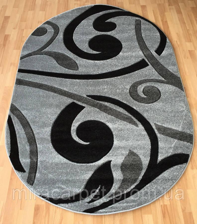 Овальный ковер серого цвета