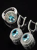 Женские украшения с фианитами. Серьги под платье + кольцо, голубой фианит, покрытие родий Код: 024822 17 размер кольца