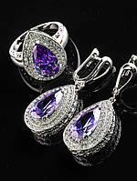 Комплект Фианит фиолетовый, серьги 24х16 мм и кольцо, капля, покрытие родий Код: 024811 18 размер кольца