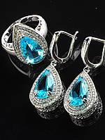 Комплект Фианит голубой капля, серьги 24х16 мм и колечко покрытие родий Код: 024815 17 р