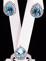 Украшения с фианитами. Комплект серьги и кольцо капля голубой фианит Фианит покрытие родий Код: 024806 18 размер кольца