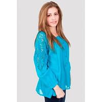 Яркая красивая женская блуза бирюзового цвета