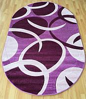 Красивый ковер на пол овальной формы розово-сиреневых тонов