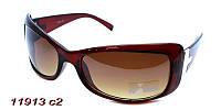 Коричневые солнцезащитные очки для девушки