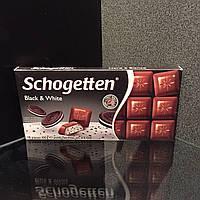 Восхитительный альпийский молочный шоколад со сливочным кремом и хрустящим печеньем Schogetten black & white