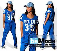 Модный женский комбинезон в спортивном стиле с рисунком на груди синий
