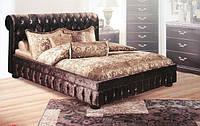 Кровать с мягким изголовьем.