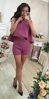 Оригинальный женский костюм с шортами и расклешенной асимметричной кофтой без рукавов габардин