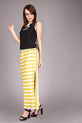 Яркая длинная женская юбка желтого цвета