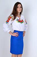 Оригинальная блуза модного кроя с яркой вышивкой